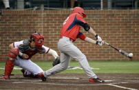 Radford's Shane Johnsonbaugh, right, drives in a run with a single against Indiana in the eighth inning of an NCAA regional college baseball game Sunday, May 31, 2015, in Nashville, Tenn. Radford won 5-3. Indiana catcher Brad Hartong, left, looks on. (AP Photo/Mark Humphrey)