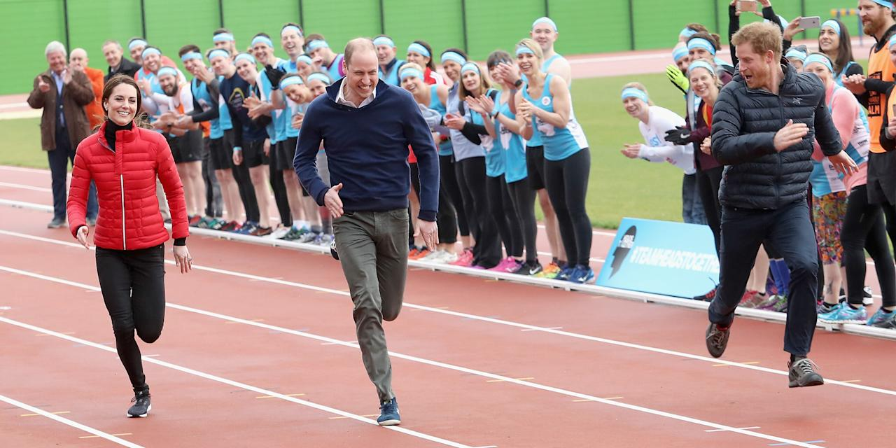 <p>Prince William, Kate Middleton, and Prince Harry race each other during the Team Heads Together at a London Marathon Training Day. </p>