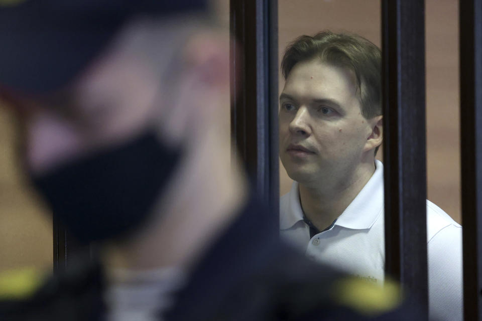 Belarus' opposition activists Maxim Znak stands in cage during a court hearing in Minsk, Belarus, Monday, Sept. 6, 2021. A court in Belarus on Monday sentenced two leading opposition activists to lengthy prison terms, the latest move in the relentless crackdown Belarusian authorities unleashed on dissent in the wake of last year's months-long anti-government protests. Maria Kolesnikova, a top member of the opposition Coordination Council, has been in custody since her arrest last September. A court in Minsk found her guilty of conspiring to seize power, creating an extremist organization and calling for actions damaging state security and sentenced her to 11 years in prison. Znak was sentenced to 10 years in prison. (Ramil Nasibulin/BelTA pool photo via AP)