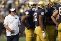 Notre Dame head coach Brian Kelly walks to a huddle as his team plays Toledo in the second half of an NCAA college football game in South Bend, Ind., Saturday, Sept. 11, 2021. Notre Dame won 32-29. (AP Photo/AJ Mast)