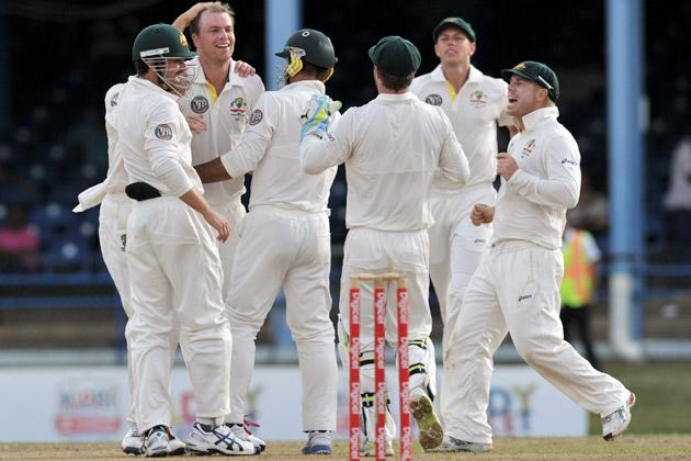 Australian bowler Michael Beer (2nd L) and teammates celebrate lbw call against West Indies batsmen Adrian Barath during the second day of the second-of-three Test matches between Australia and West Indies April 16, 2012 at Queen's Park Oval in Port of Spain, Trinidad. AFP PHOTO/Stan HONDA