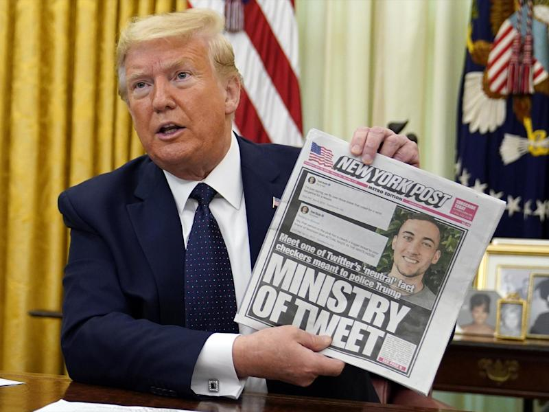 President Donald Trump holds up a copy of the New York Post as he speaks before signing an executive order aimed at curbing protections for social media giants: (2020 The Associated Press)