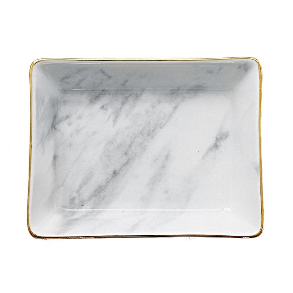 """If you need something that's practical and classic, you can't go wrong with a jewelry dish. <br><br><strong>SOCOSY</strong> SOCOSY Marble Ceramic Ring Dish, $, available at <a href=""""https://www.amazon.com/SOCOSY-Ceramic-Jewelry-Organizer-Wedding/dp/B077MZVX37/"""" rel=""""nofollow noopener"""" target=""""_blank"""" data-ylk=""""slk:Amazon"""" class=""""link rapid-noclick-resp"""">Amazon</a>"""
