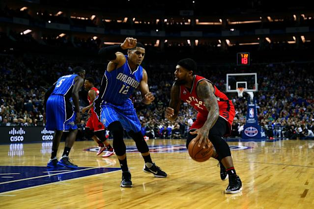 LONDON, ENGLAND - JANUARY 14: James Johnson #3 of the Toronto Raptors drives against Tobias Harris #12 of the Orlando Magic during the 2016 NBA Global Games London match between Toronto Raptors and Orlando Magic at The O2 Arena on January 14, 2016 in London, England. (Photo by Clive Rose/Getty Images)