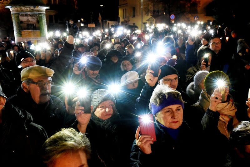 People take part in an anti-government protest in support of free judiciary in Olsztyn