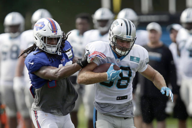 Carolina Panthers' Greg Olsen runs the ball while Buffalo Bills' Tremaine Edmunds reaches for the tackle during an NFL football training camp in Spartanburg, S.C., Wednesday, Aug. 14, 2019. (AP Photo/Gerry Broome)