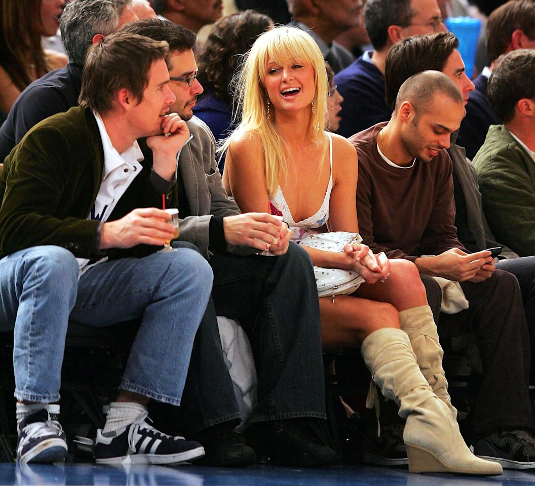 Paris Hilton talks to Ethan Hawke (left) courtside at the Atlanta Hawks game against the New York Knicks in 2004.