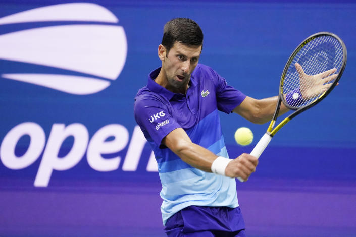 Novak Djokovic, of Serbia, returns against Jenson Brooksby, of the United States, during the fourth round of the U.S. Open tennis championships, Monday, Sept. 6, 2021, in New York. (AP Photo/John Minchillo)