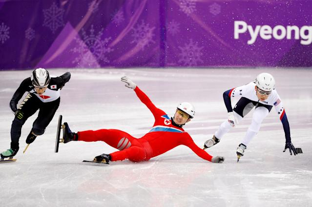 FILE PHOTO: Short Track Speed Skating Events - Pyeongchang 2018 Winter Olympics - Men's 500 m Competition - Gangneung Ice Arena - Gangneung, South Korea - February 20, 2018. Keita Watanabe of Japan and Thomas Insuk Hong of the U.S in action as Jong Kwang Bom of North Korea falls. REUTERS/John Sibley/File Photo