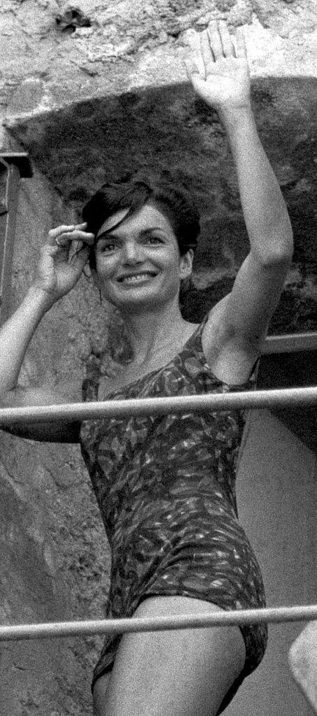 Jackie Kennedy in a patterned one-piece. (Photo: Getty Images)