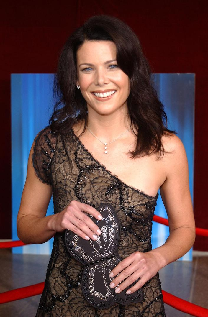 <p><em>Gilmore Girls </em>star Lauren Graham accessorized her 2001 Emmys ensemble with perhaps the most 2001 accessory ever: a butterfly clutch. </p>
