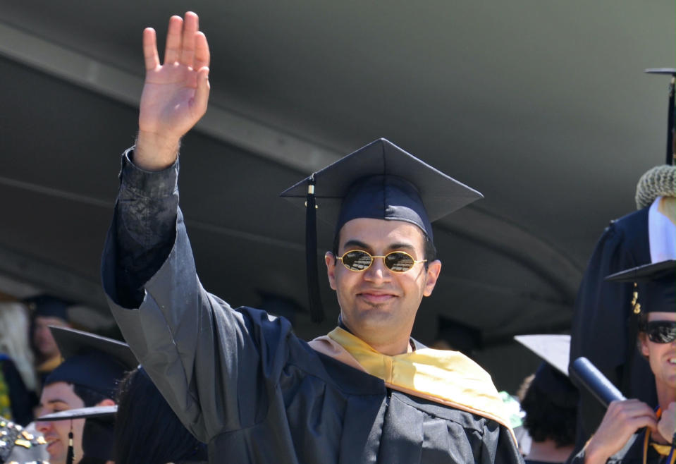 In this photo provided by the family of Abdulrahman al-Sadhan, Abdulrahman al-Sadhan poses for a graduation photo at Notre Dame de Namur University, a private Catholic university, in Belmont, California, May 4, 2013. Saudi humanitarian aid worker Abdulrahman al-Sadhan's anonymous Twitter account used to parody issues about the economy in Saudi Arabia has landed him in prison in the kingdom. But his story may have roots in an elaborate ploy that began in Silicon Valley and sparked a federal case against two Twitter employees accused of spying for the kingdom. (Family of Abdulrahman al-Sadhan via AP)
