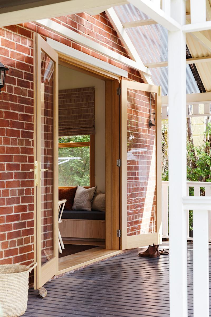 """""""The windows did not frame the outside and invite the light in, but were wherever the original rooms were divided,"""" Kate notes. As part of the renovation, Fabrikate increased the height of the patio door to the deck, to create more light and flow to the outdoors."""