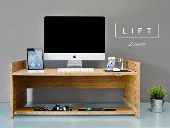 This desk features both standing and sitting options, and turns any desk into a standing desk. Plus, it's hand built in the USA.<span>Shop it here</span>.