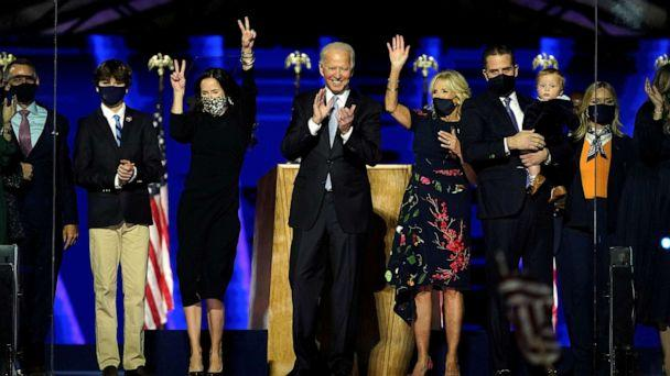 PHOTO: President-elect Joe Biden is accompanied on the stage by his wife Jill, and members of their family, after speaking in Wilmington, Del., Nov. 7, 2020. (Andrew Harnik/Pool via Reuters)