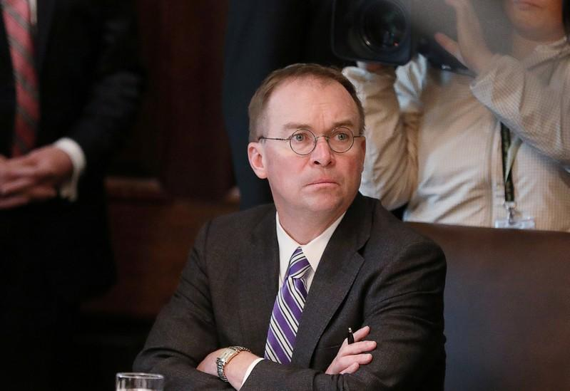 FILE PHOTO: Acting White House Chief of Staff Mulvaney listens during Trump cabinet meeting at the White House in Washington