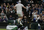 Britain's Andy Murray celebrates winning the men's singles second round match against Germany's Oscar Otteon day three of the Wimbledon Tennis Championships in London, Wednesday June 30, 2021. (AP Photo/Alastair Grant)