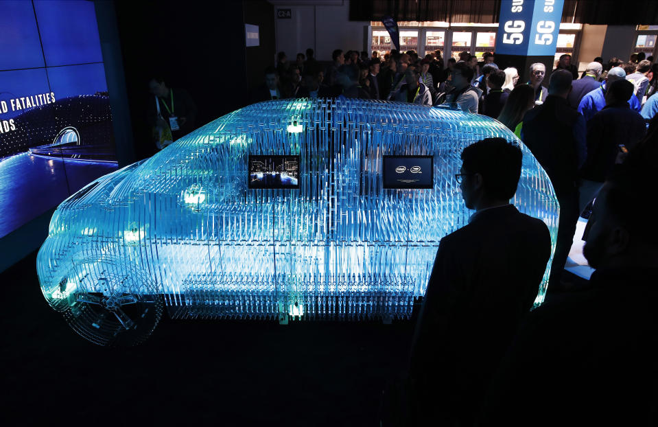 FILE - In this Jan. 9, 2018, file photo a model of a car displays Intel Mobileye sensor technology at the Intel booth during CES International in Las Vegas. Intel Corp. reports financial earnings on Thursday, July 25, 2019. (AP Photo/John Locher, File)