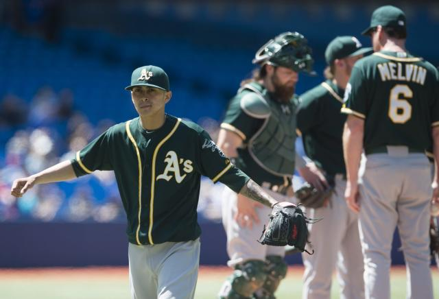 Oakland Athletics starting pitcher Jesse Chavez walks off the mound after getting pulled in the sixth inning of a baseball game against the Toronto Blue Jays in Toronto on Saturday, May 24, 2014.(AP Photo/The Canadian Press, Darren Calabrese)