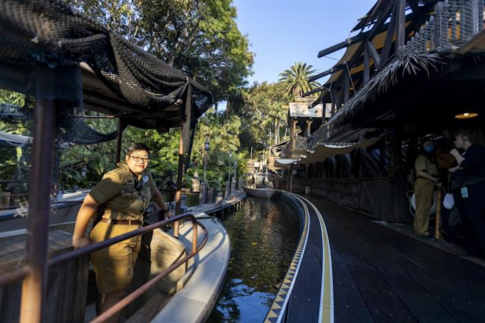 Skipper Amanda Beth Lorenzo stands in the Jungle Cruise boat at the entrance to the ride