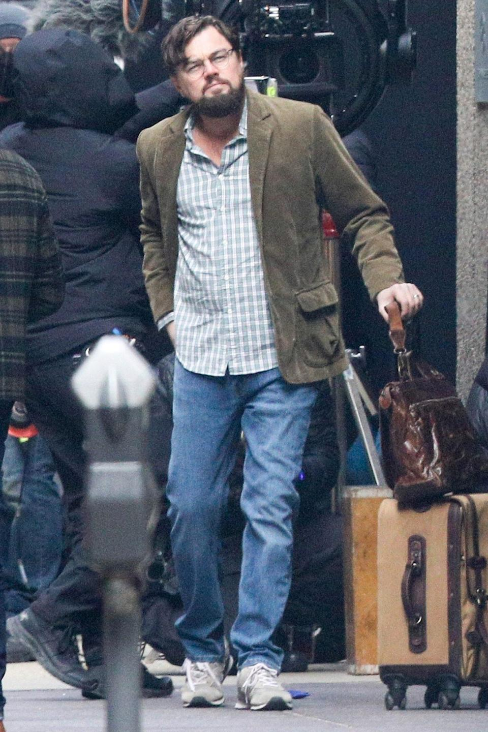 <p>Leonardo DiCaprio gets into character while filming a scene for <em>Don't Look Up</em> in downtown Boston on Monday. </p>