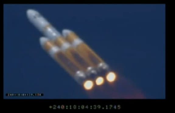 This screengrab from a launch webcast shows America's secret NROL-65 spy satellite heading toward space on Aug. 28, 2013, borne aloft by a Delta 4 Heavy rocket.