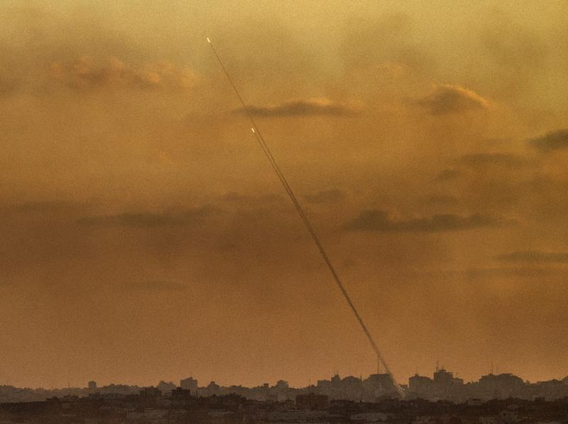 A picture taken from the southern Israeli Gaza border shows rockets being fired from the Gaza strip into Israel, on July 24, 2014 (AFP Photo/Jack Guez)