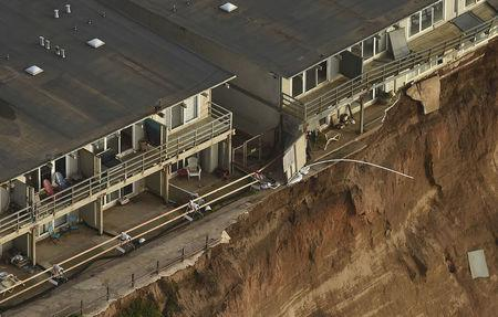 FILE PHOTO: Uninhabitable apartments, in danger of collapsing into the Pacific Ocean, line Esplanade Ave. in Pacifica, California January 26, 2016. REUTERS/Noah Berger/File Photo