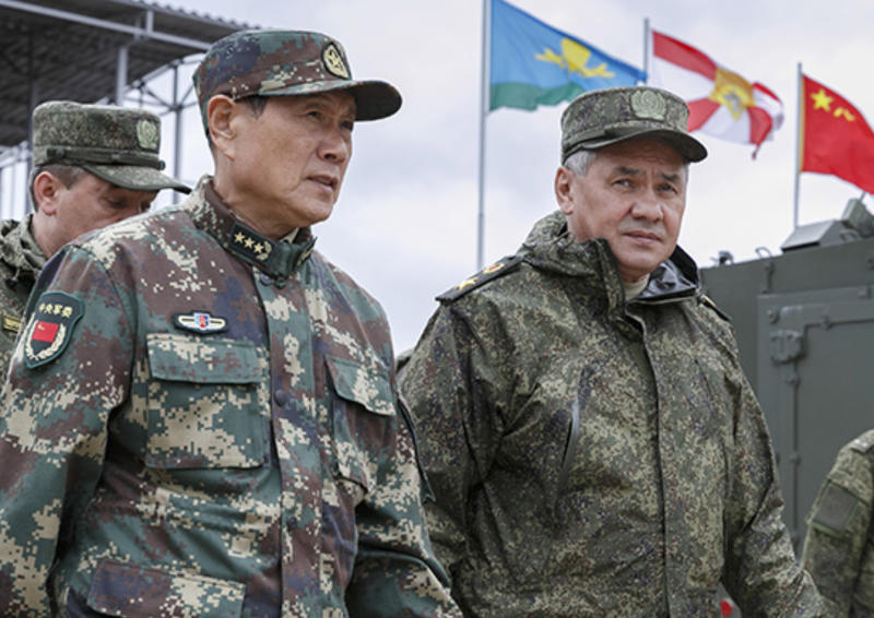 In this photo provided by Russian Defense Ministry Press Service on Wednesday, Sept. 12, 2018, Russian Defense Minister Sergei Shoigu, right, and his Chinese counterpart, Gen. Wei Fenghe, visit the Tsugol firing range in eastern Siberia where nearly 300,000 Russian troops and about 3,200 Chinese troops are participating in joint exercises. (Russian Defense Ministry Press Service pool photo via AP)