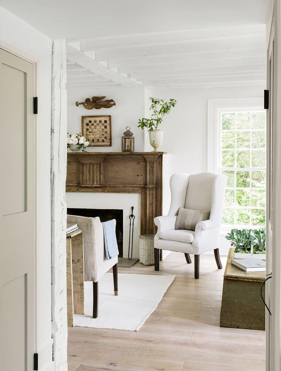 <p>Enhance a wooden mantel with complementary accessories, like a vintage-inspired lantern, to add character to your space. </p>