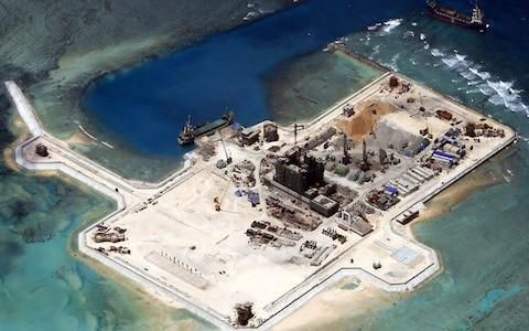 construction at the disputed Spratley Islands in the south China Sea by China - Credit: ARMED FORCES OF THE PHILIPPINES
