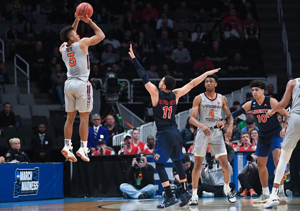 <p>Wabissa Bede #3 of the Virginia Tech Hokies shoots in front of Georgie Pacheco-Ortiz #11 of the Liberty Flames in the second round of the 2019 NCAA Men's Basketball Tournament held at SAP Center on March 24, 2019 in San Jose, California. (Photo by Justin Tafoya/NCAA Photos via Getty Images) </p>