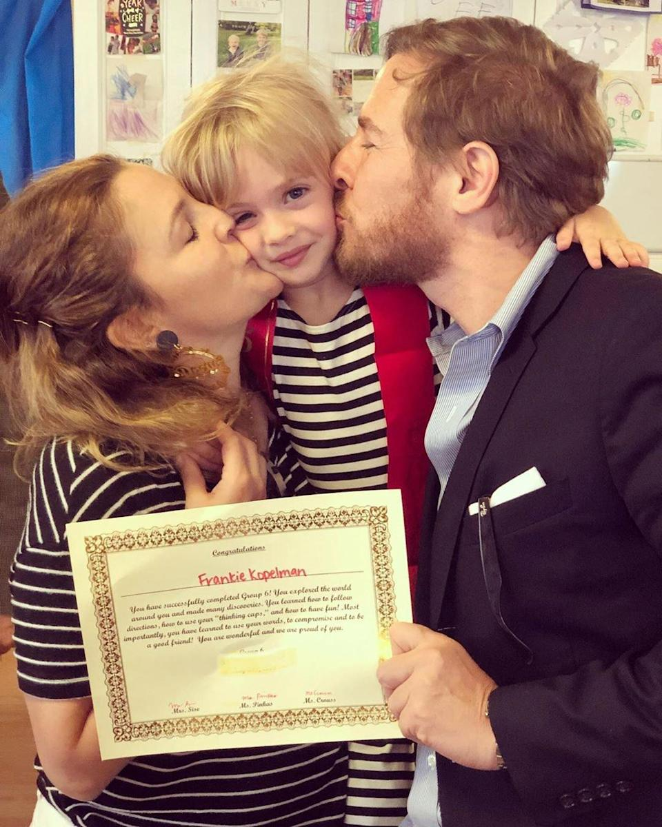 """Congratulations are in order for proud parents Drew Barrymore and Will Kopelman! The former couple reunited to celebrate their 5-year-old daughter Frankie's graduation. Kopelman <a href=""""https://www.instagram.com/p/ByGXA1bHukv/"""" rel=""""nofollow noopener"""" target=""""_blank"""" data-ylk=""""slk:posted a shot"""" class=""""link rapid-noclick-resp"""">posted a shot</a> from Frankie's big day on Instagram, which shows both himself and ex-wife Barrymore kissing their little girl on her cheeks. """"Graduate 🎓,"""" Kopelman captioned the darling photo. Frankie's graduation comes just a month after her <a href=""""https://www.instagram.com/p/Bwj6U0lpM1J/"""" rel=""""nofollow noopener"""" target=""""_blank"""" data-ylk=""""slk:5th birthday"""" class=""""link rapid-noclick-resp"""">5th birthday</a>."""
