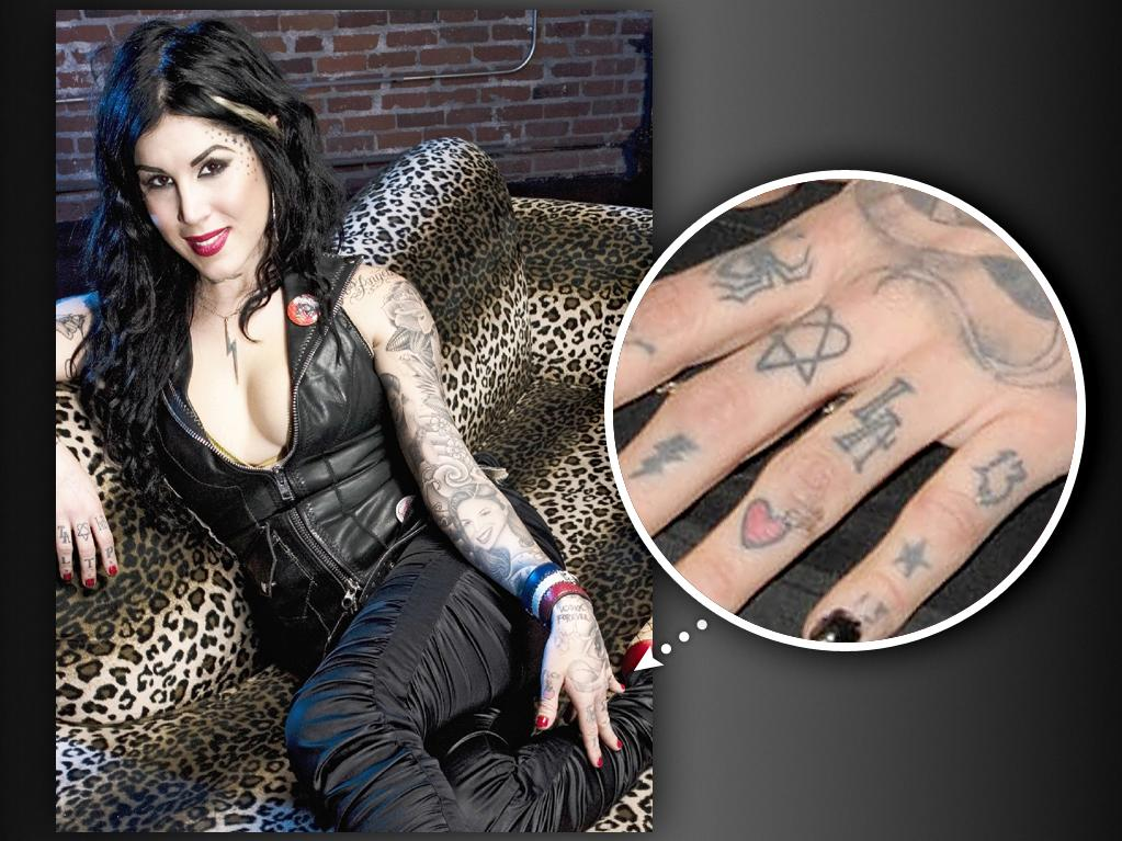 "Kat also loves Los Angeles, saying she feels married to the SoCal city, and so -- amid all the other tattoos Kat has on her fingers -- ""L.A."" adorns her left ring finger."
