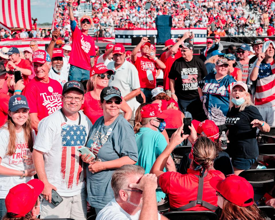Attendees gather before Trump's Florida rally.