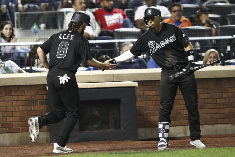 Atlanta Braves' Charlie Culberson (8) celebrates with Rafael Ortega after scoring during the ninth inning of the team's baseball game against the New York Mets, Saturday, Aug. 24, 2019, in New York. (AP Photo/Mary Altaffer)