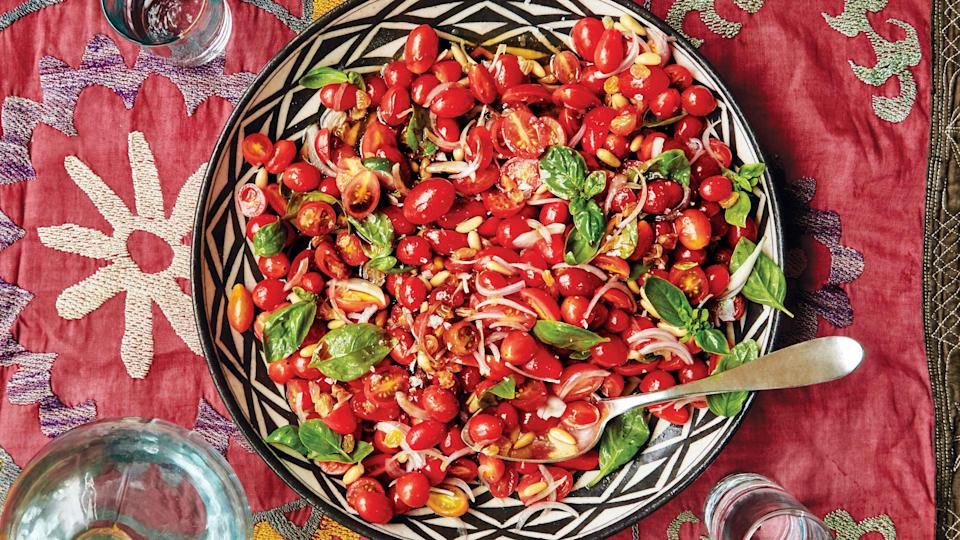 "The secret weapon in this summery salad is the golden raisins: They're soaked in apple cider vinegar, which not only sweetens the vinegar but also transforms them into plump, sweet-tart balloons that stand up against the rich and buttery pine nuts. Check out our other <a href=""https://www.bonappetit.com/gallery/tawlet-beirut-lebanese-cuisine?mbid=synd_yahoo_rss"" rel=""nofollow noopener"" target=""_blank"" data-ylk=""slk:recipes for a truly flavorful Lebanese feast here"" class=""link rapid-noclick-resp"">recipes for a truly flavorful Lebanese feast here</a>. <a href=""https://www.bonappetit.com/recipe/tomato-salad-with-pine-nuts-and-pomegranate-molasses?mbid=synd_yahoo_rss"" rel=""nofollow noopener"" target=""_blank"" data-ylk=""slk:See recipe."" class=""link rapid-noclick-resp"">See recipe.</a>"