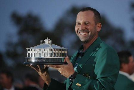 Sergio Garcia of Spain wears his green jacket and holds the Masters trophy after winning the 2017 Masters in Augusta