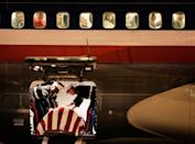 <p>2005. Marines drape a flag over 2nd Lieut. James Cathey's casket at the airport in Reno, Nevada. Cathey, 24, died August 21, 2005, when a roadside bomb exploded near Al Karmah, Iraq.</p>