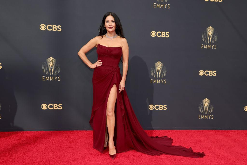 Catherine Zeta-Jones opted for a burgandy gown which had a daring thigh-high split at last night's Emmy Awards. (Rich Fury/Getty Images)