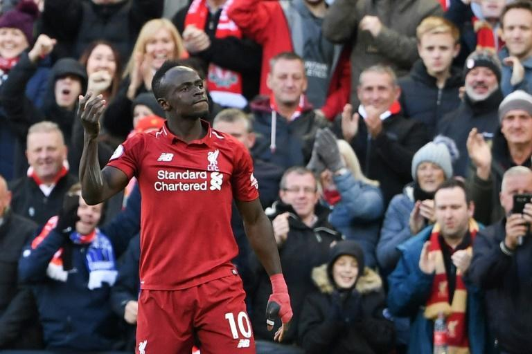 Sadio Mane celebrates after scoring his first goal and Liverpool's second in a 4-1 win at home to Cardiff
