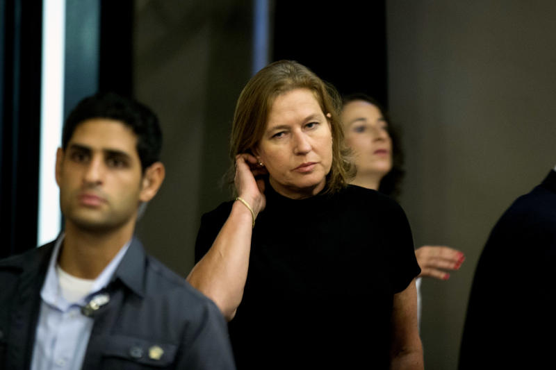 Tzipi Livni, Israel's chief negotiator with the Palestinians, arrives tothe weekly cabinet meeting in Jerusalem, Sunday, July 21, 2013. The Israeli cabinet marked the 100th anniversary of the birth of former Israeli Prime Minister Menachem Begin by holding the meeting at the Menachem Begin Heritage Center. (AP Photo/Uriel Sinai, Pool)