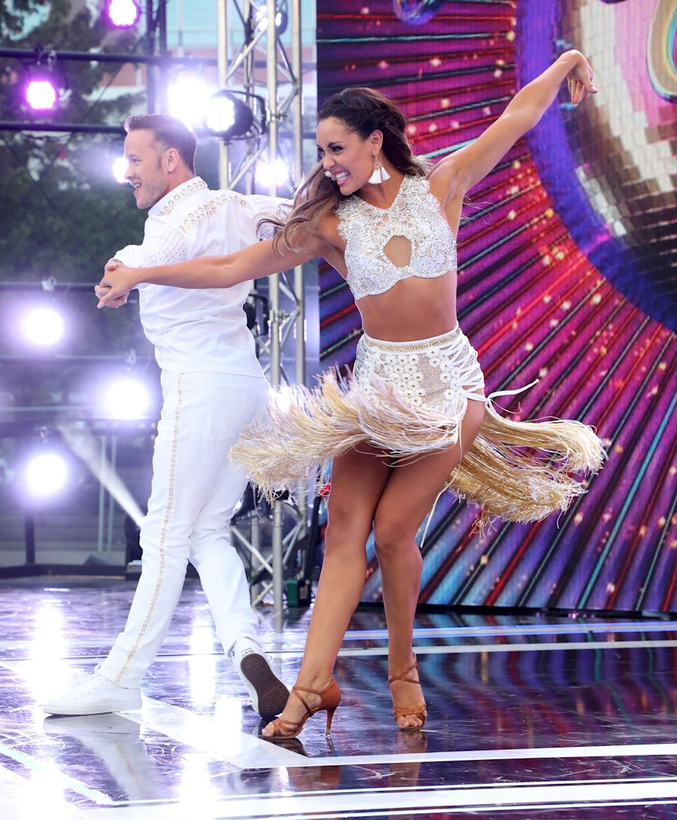 """LONDON, ENGLAND - AUGUST 26:  Amy Dowden and Kevin Clifton on stage at the """"Strictly Come Dancing"""" launch show at Television Centre on August 26, 2019 in London, England. (Photo by Lia Toby/Getty Images)"""