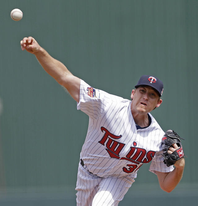 Minnesota Twins starting pitcher Kevin Correia (30) pitches in the first inning during an exhibition baseball game against the Pittsburgh Pirates in Fort Myers, Fla., Wednesday, March 12, 2014. (AP Photo/Gerald Herbert)