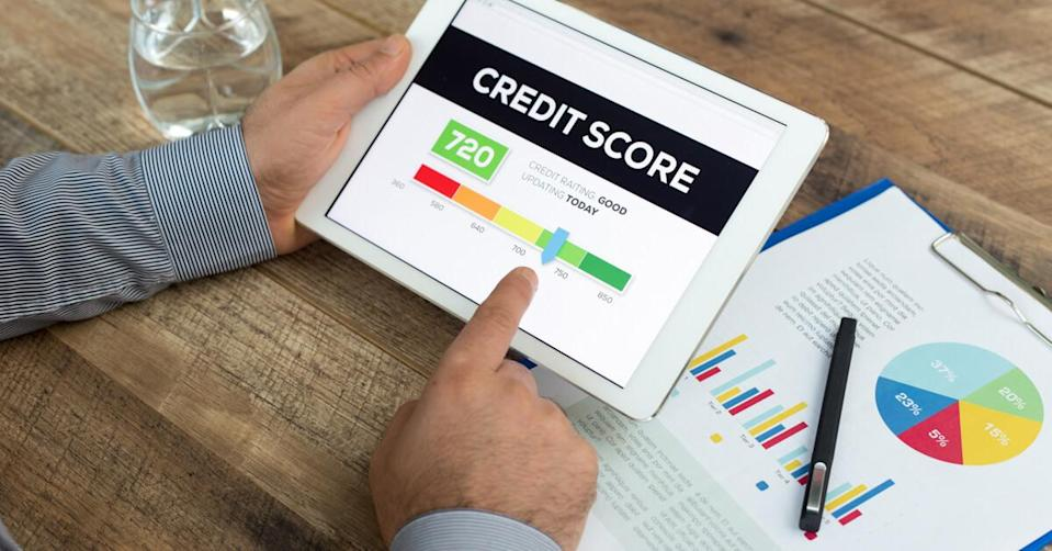 Man holding a tablet showing Credit Score concept.