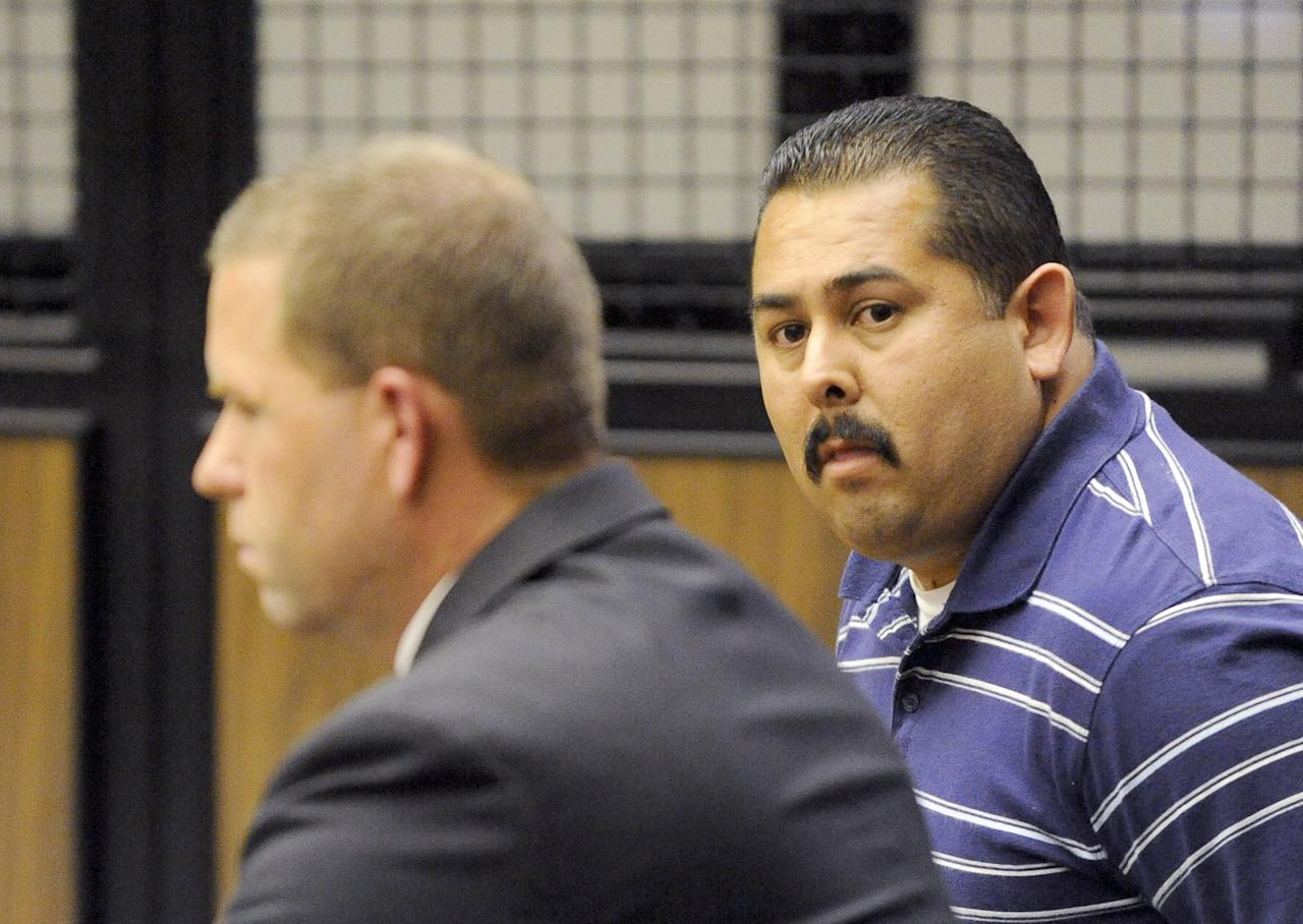 Fullerton, Calif., police officer Manuel Ramos, right, and Cpl. Jay Cicinelli are arraigned on charges in the death of a homeless man, Kelly Thomas, in Superior Court in Santa Ana, Calif., Wednesday, Sept. 21, 2011. Ramos was charged with one count each of second degree murder and involuntary manslaughter in the death of Thomas after a violent confrontation in Fullerton on July 5. Cicinelli was charged with one count each of involuntary manslaughter and excessive force. (AP Photo/Paul Rodriguez, Pool)