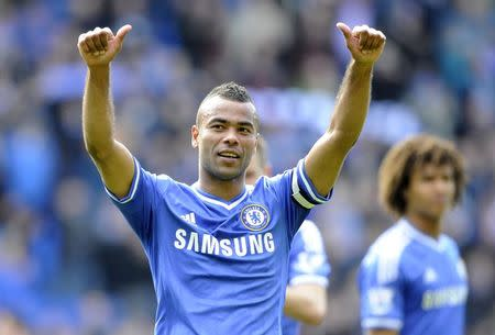 Chelsea's Ashley Cole acknowledges the Chelsea fans during their English Premier League soccer match at Cardiff City Stadium in Cardiff, Wales, May 11, 2014. REUTERS/Rebecca Naden