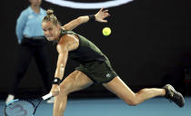 Arantxa Rus of the Netherlands makes a backhand return to Madison Keys of the U.S. during their second round singles match at the Australian Open tennis championship in Melbourne, Australia, Wednesday, Jan. 22, 2020. (AP Photo/Dita Alangkara)