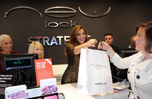 Eh? Kelly Brook working in a shop? No, she's not looking for extra cash – the star opened the New Look store in Westfield Stratford City.