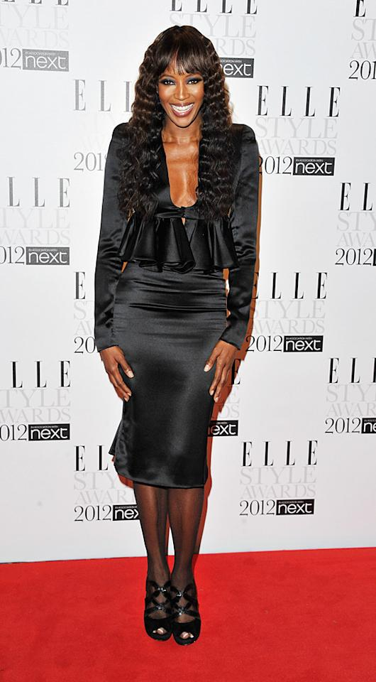 Naomi Campbell hit the red carpet at the 2012 U.K. Elle Style Awards -- held at the Savoy Hotel in London -- wearing a low-cut black frock and crimped locks. The supermodel presented Alexander McQueen creative director Sarah Burton with the International Designer of the Year Award. (2/13/2012)